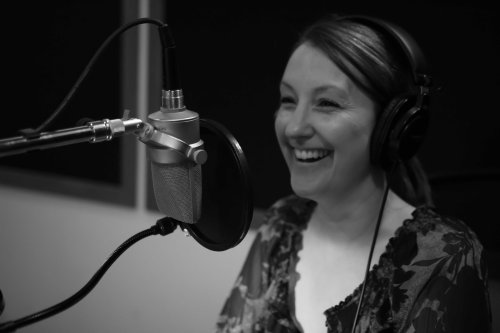 DVW Head Writer and Trainer, Miranda Mackelworth, gets a taste of what its like in the sound booth for our professional voice talent